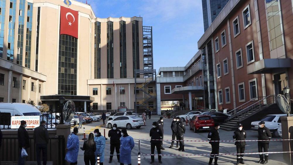 Police and medics gather outside the privately-run Sanko University Hospital in Gaziantep, southeastern Turkey, Saturday, Dec. 19, 2020 (Kadir Gunes/DHA via AP)