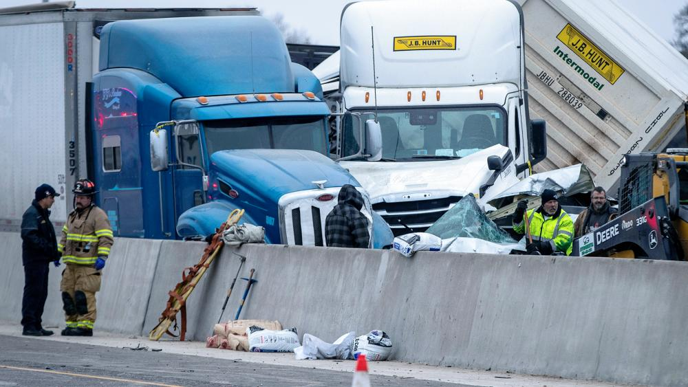 First responders cleanup after a massive pileup on I-35W Thursday, Feb. 11, 2021, near downtown Fort Worth, Texas. At least six people were killed and dozens injured (Yffy Yossifor/Star-Telegram via AP)