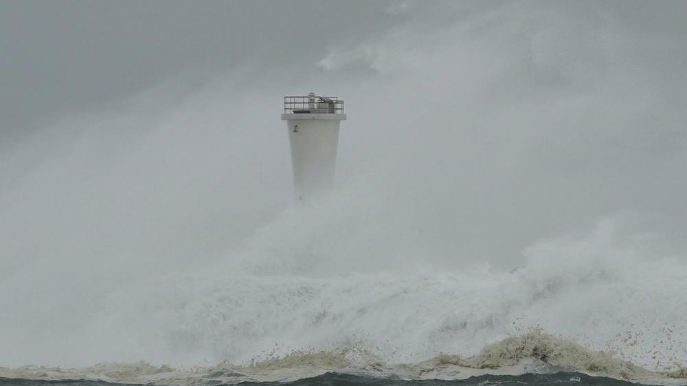 Surging waves hit against the breakwater and a lighthouse as Typhoon Hagibis approaches at a port in town of Kiho, Mie prefecture, central Japan Saturday, Oct. 12, 2019 (AP Photo/Toru Hanai)
