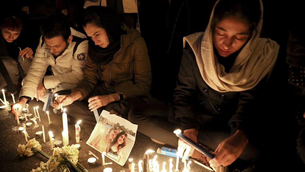 Candlelight vigil to remember the victims of the Ukraine plane crash, at the gate of Amri Kabir University where some of the victims of the crash were students, in Tehran, Iran, Saturday, Jan. 11, 2020. (AP Photo/Ebrahim Noroozi)
