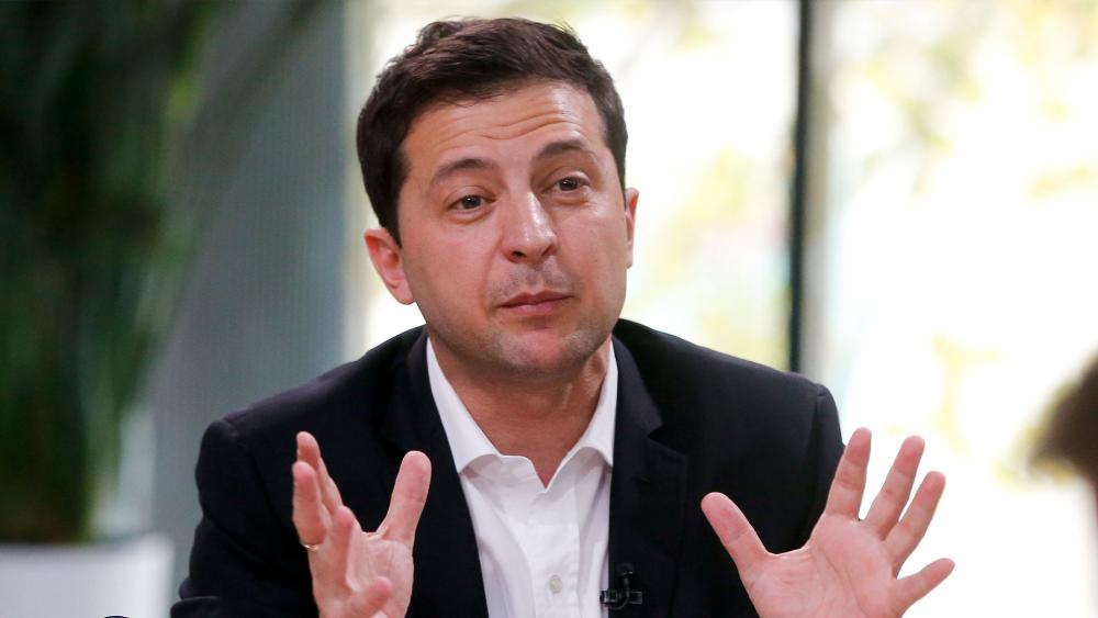 Ukrainian President Volodymyr Zelenskiy speaks during talks with journalists in Kyiv, Ukraine, Thursday, Oct. 10, 2019.  (AP Photo/Efrem Lukatsky)