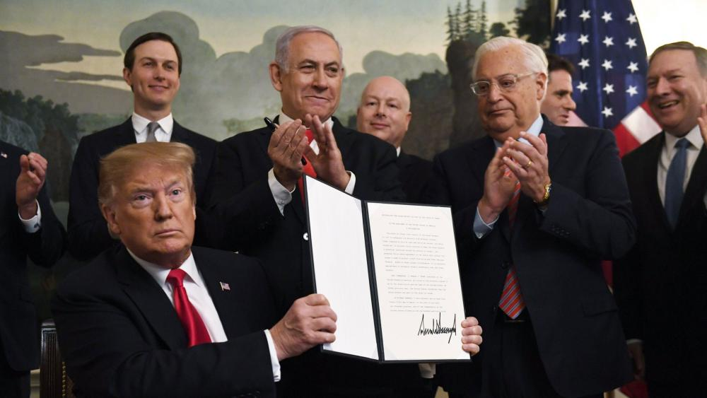 President Donald Trump holds up a signed proclamation recognizing Israel's sovereignty over the Golan Heights, as Israeli Prime Minister Benjamin Netanyahu looks on in the Diplomatic Reception Room of the White House in Washington. (AP Photo/Susan Walsh)