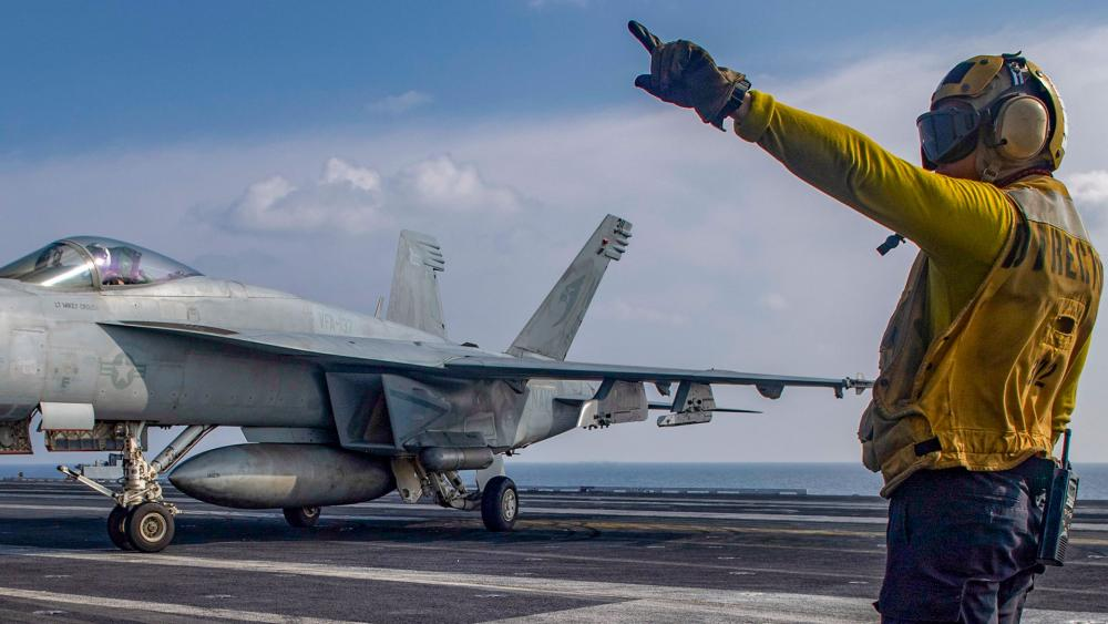 Aviation Boatswain's Mate 3rd Class Marnell Maglasang directs an F/A-18E Super Hornet on the aircraft carrier USS Nimitz in the Arabian Sea, Nov. 27, 2020. (Mass Communication Specialist 3rd Class Cheyenne Geletka/U.S. Navy via AP)