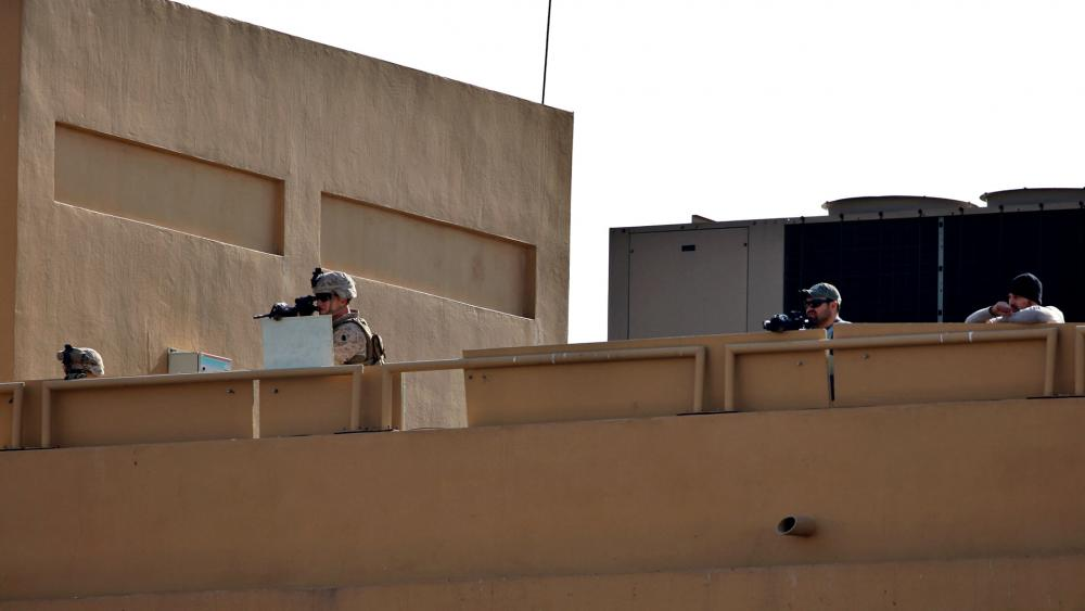 U.S. soldiers stand guard on the roof of the U.S. embassy in Baghdad against pro-Iranian militiamen and their supporters, Jan. 1, 2020.  (AP Photo/Khalid Mohammed)