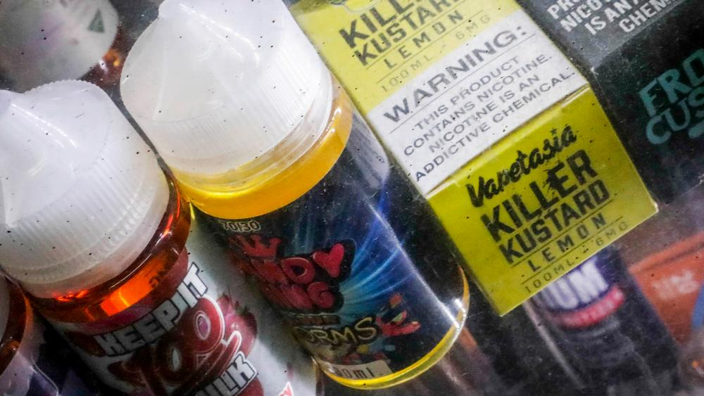 In this Sept. 16, 2019 file photo flavored vaping solutions are shown in a window display at a vape and smoke shop, in New York. ( (AP Photo/Bebeto Matthews File)