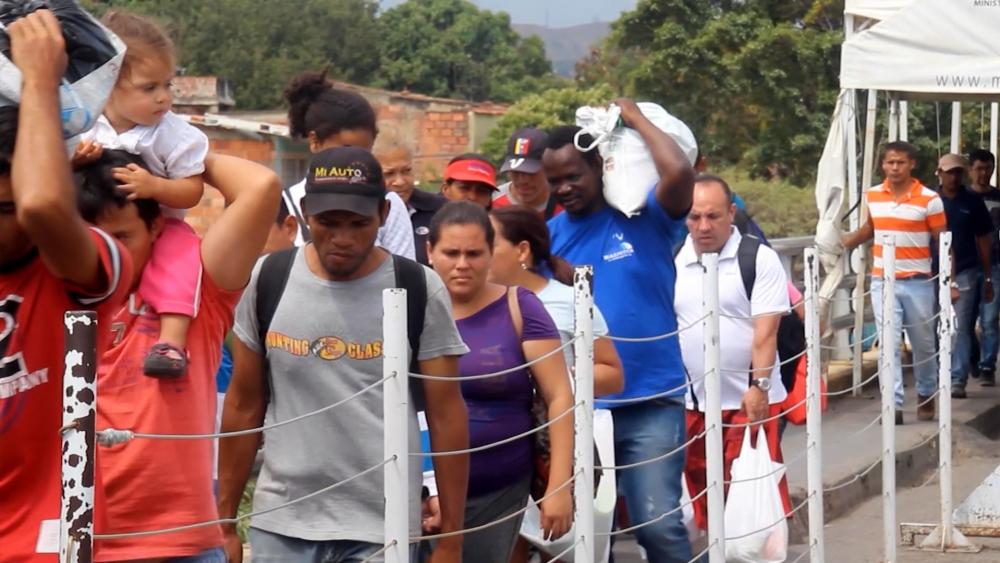 Migrants from Venezuela crossing into Colombia. (Image credit: CBN News)