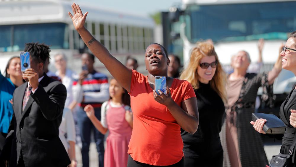 Members of the Life Tabernacle Church worship as they wait for their pastor Tony Spell who was arrested in Baton Rouge, La., April 21, 2020. (AP Photo/Gerald Herbert)