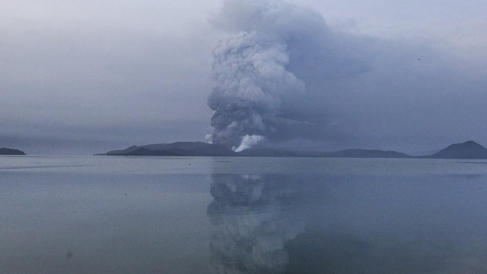 Taal volcano spews ash in view from Batangas, southern Philippines on Monday, Jan. 13, 2020. (AP Photo/Gerrard Carreon)