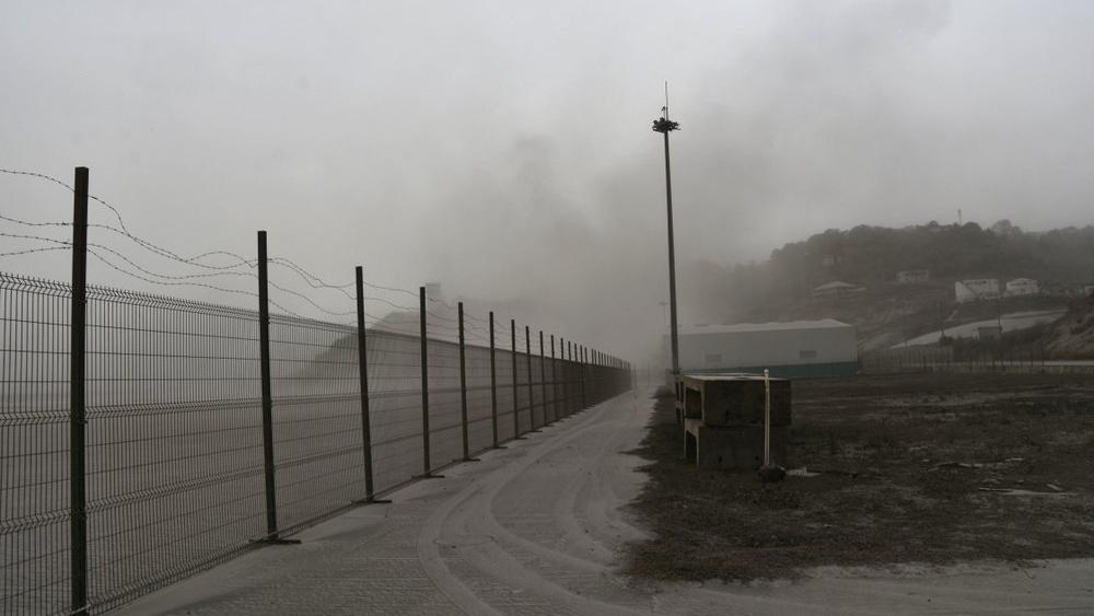 A road is blanketed in volcanic ash at the international airport in Kingstown, on the eastern Caribbean island of St. Vincent (AP Photo/Orvil Samuel)