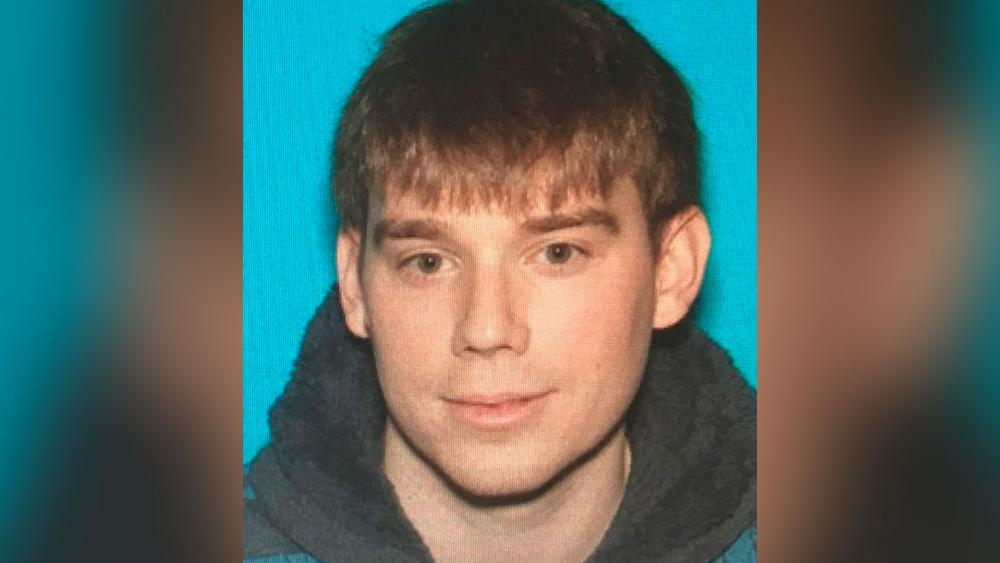 This photo provided by the Metro Nashville Police Department shows Travis Reinking, who police took into custody Monday in connection with a fatal shooting at a Waffle House restaurant in the Antioch neighborhood of Nashville early Sunday.