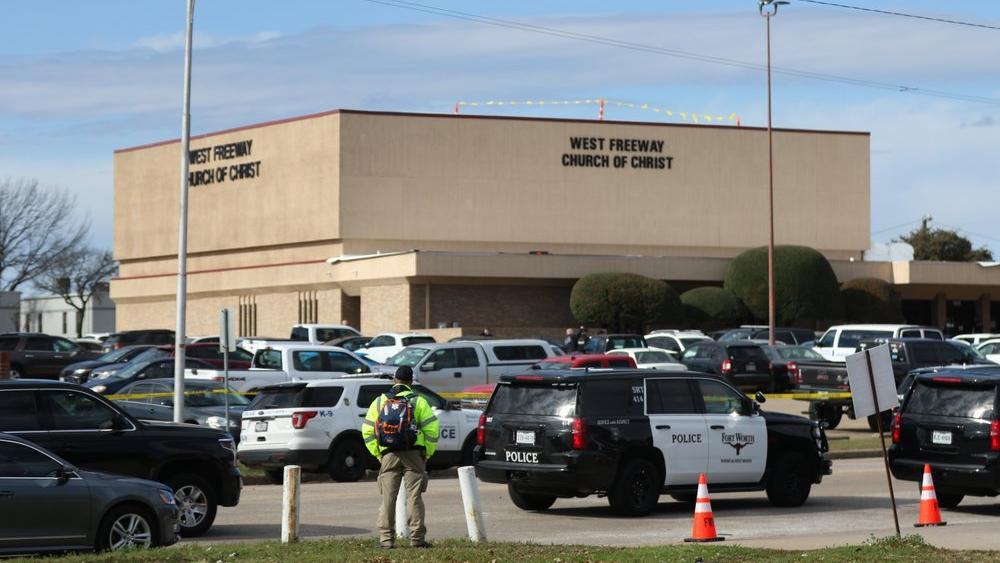 A person stands near the scene of a church shooting at West Freeway Church of Christ on Sunday, Dec. 29, 2019 in White Settlement, Texas. (Juan Figueroa/The Dallas Morning News via AP)