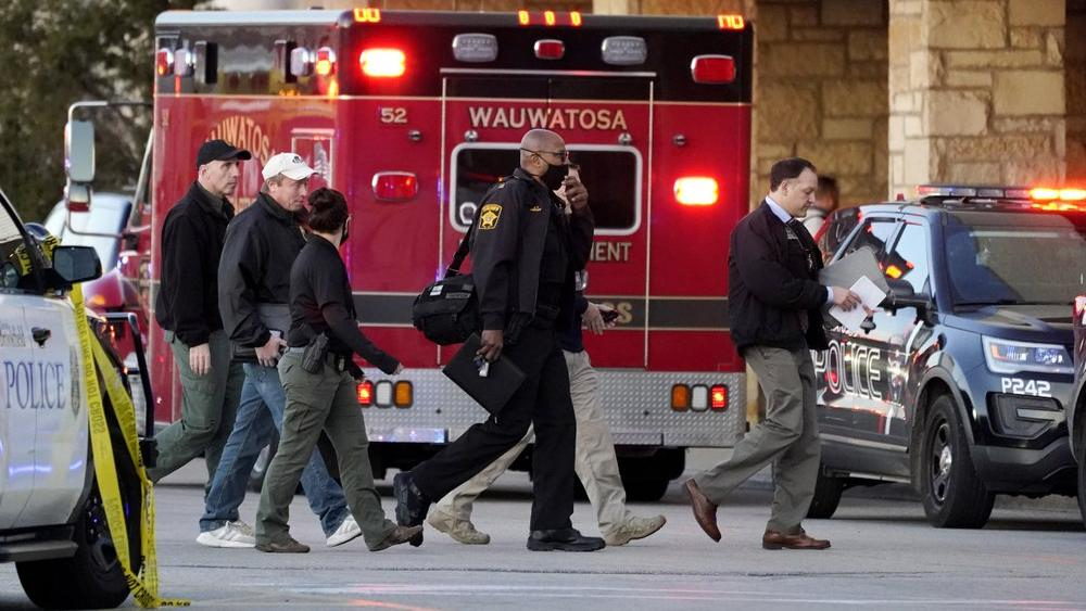 Police officials walk to the Mayfair Mall, Friday, Nov. 20, 2020, in Wauwatosa, Wis. (AP Photo/Nam Y. Huh)