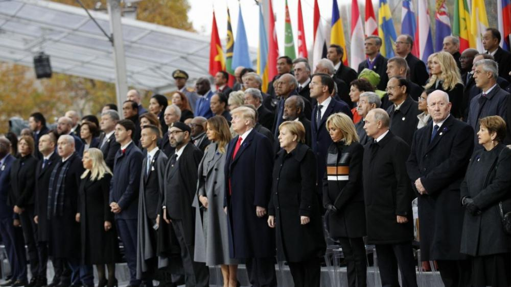 Over 60 heads of state and government were taking part in a solemn ceremony at the Tomb of the Unknown Soldier, the mute and powerful symbol of sacrifice to the millions who died from 1914-18. AP Photo.
