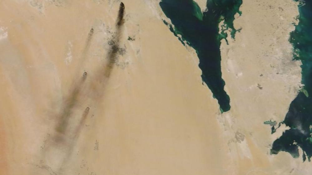 Satellite image provided by NASA Worldview shows fires following Yemen's Houthi rebels claiming a drone attack on two major oil installations in eastern Saudi Arabia (NASA Worldview via AP)