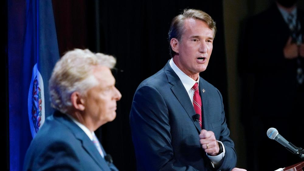 Republican Glenn Youngkin, right, debates Democratic candidate Terry McAuliffe in the Virginia governor's race (AP Photo/Steve Helber)