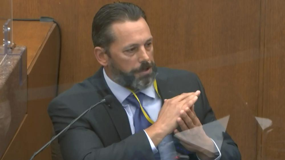 In this image from video, Minneapolis Police Lt. Johnny Mercil, a use of force trainer, testifies as Hennepin County Judge Peter Cahill presides Tuesday, April 6, 2021. (Court TV via AP, Pool)
