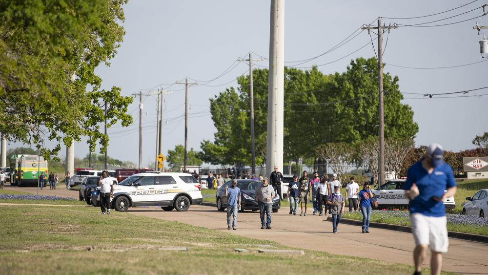 Police responded to a shooting at Kent Moore Cabinets on Thursday, April 8, 2021, in Bryan, Texas. (Cassie Stricker/College Station Eagle via AP)