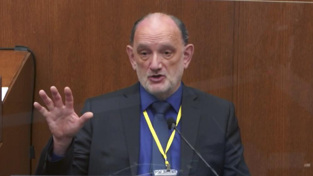 In this image from video, Dr. David Fowler, a retired forensic pathologist and former chief medical examiner for the state of Maryland testifies. (Court TV via AP, Pool)