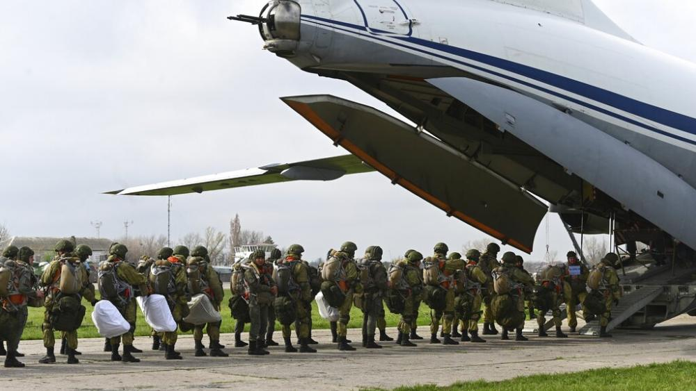 Russian paratroopers load into a plane for airborne drills during maneuvers in Taganrog, Russia, Thursday, April 22, 2021. (AP Photo)