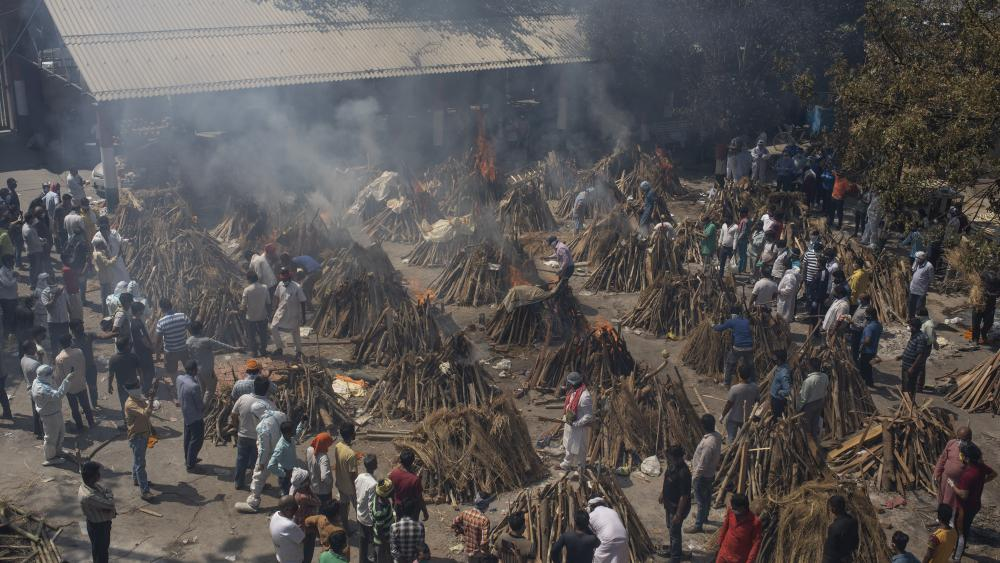 In this April 24, 2021, file photo, multiple funeral pyres of those who died of COVID-19. (AP Photo/Altaf Qadri, File)