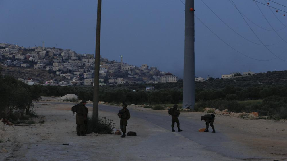 Israeli soldiers set up a roadblock as part of a security operation in the village of Aqraba, near the West Bank town of Nablus, Monday, May 3, 2021. (AP Photo/Majdi Mohammed)
