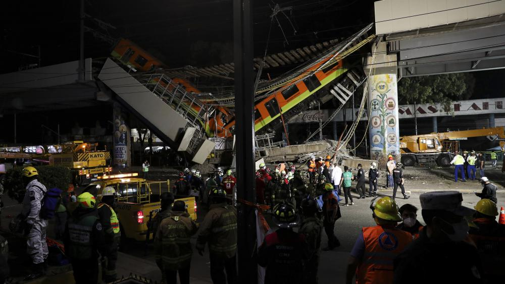 Mexico City's subway cars lay at an angle after a section of Line 12 of the subway collapsed in Mexico City, Tuesday, May 4, 2021. (AP Photo/Marco Ugarte)