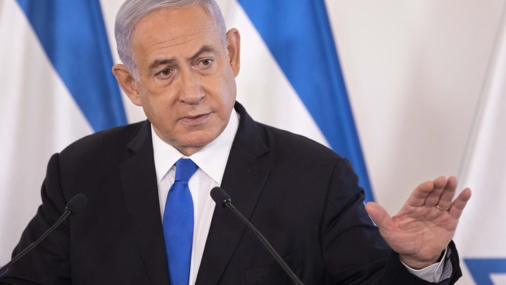 Israeli Prime Minister Benjamin Netanyahu gestures as he speaks during a briefing to ambassadors to Israel at the Hakirya military base in Tel Aviv, Israel, Wednesday, May 19, 2021. (AP Photo/Sebastian Scheiner, Pool)