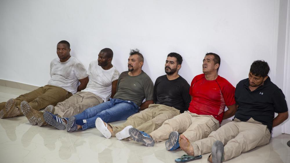 Suspects in the assassination of Haiti's President Jovenel Moise, among them Haitian-American citizens James Solages, left, and Joseph Vincent, second left. (AP Photo/Joseph Odelyn)