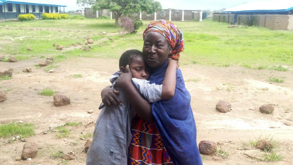 Parents are reunited with released students of the Bethel Baptist High School in Damishi, Nigeria, on Sunday, July 25, 2021.(AP Photo)