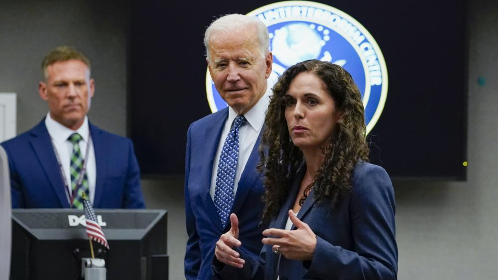 President Joe Biden listens as Director of the National Counterterrorism Center Christine Abizaid speaks during a visit to the Office of the Director of National Intelligence in McLean, Va., Tuesday, July 27, 2021. (AP Photo/Susan Walsh)