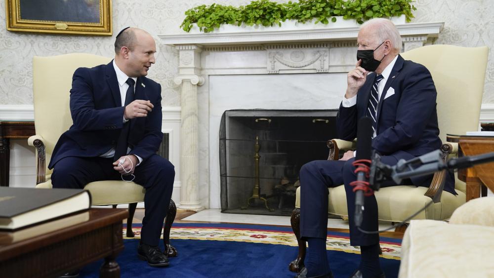Israeli Prime Minister Naftali Bennett speaks as he meets with President Joe Biden in the Oval Office of the White House, Friday, Aug. 27, 2021, in Washington. (AP Photo/Evan Vucci)