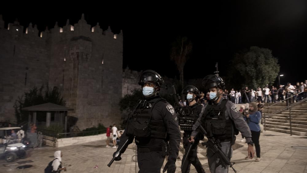 Israeli police clear protesters from the plaza in front of the Damascus Gate to Jerusalem's Old City, where dozens celebrated the escape of six Palestinian prisoners, Wednesday, Sept. 8, 2021. (AP Photo/Maya Alleruzzo)