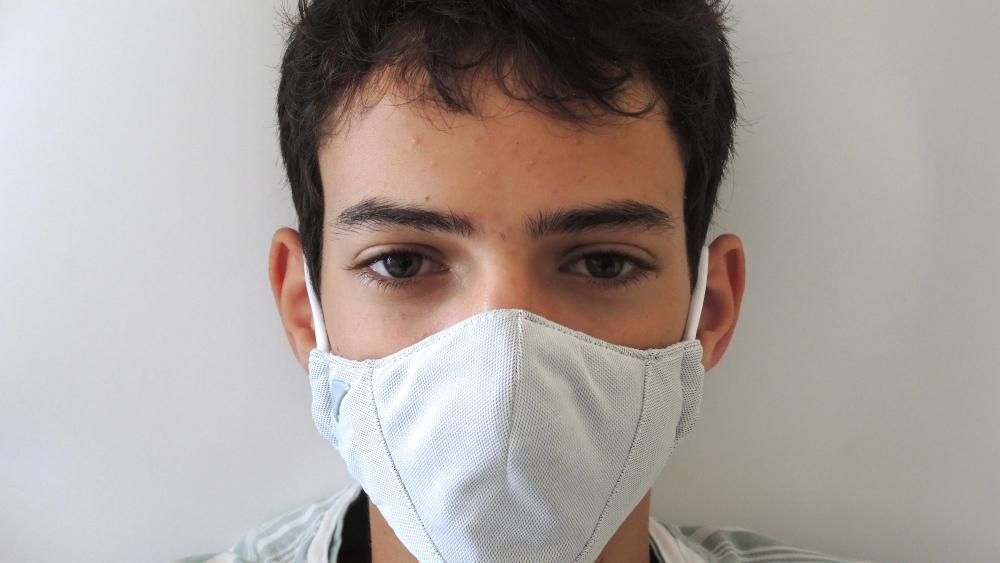 A man wearing a prototype of Argaman Technologies' antiviral face masks developed in Jerusalem