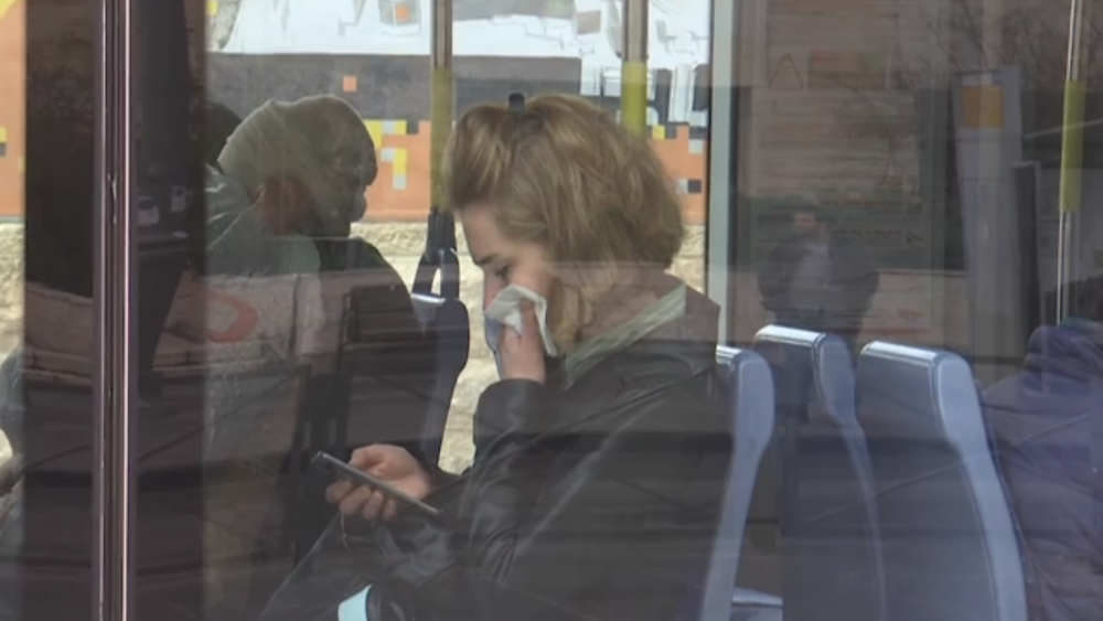 A passenger on Jerusalem's light rail covering her mouth and nose. 15 March 2020.