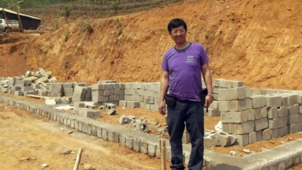 Rev. John Sanqiang Cao breaks a ground on a new school in Wa State, Myanmar. The prominent Chinese pastor who has been detained by Chinese authorities since March 5, 2017 was sentenced in March 2018 to seven years in prison. (AP Photo)