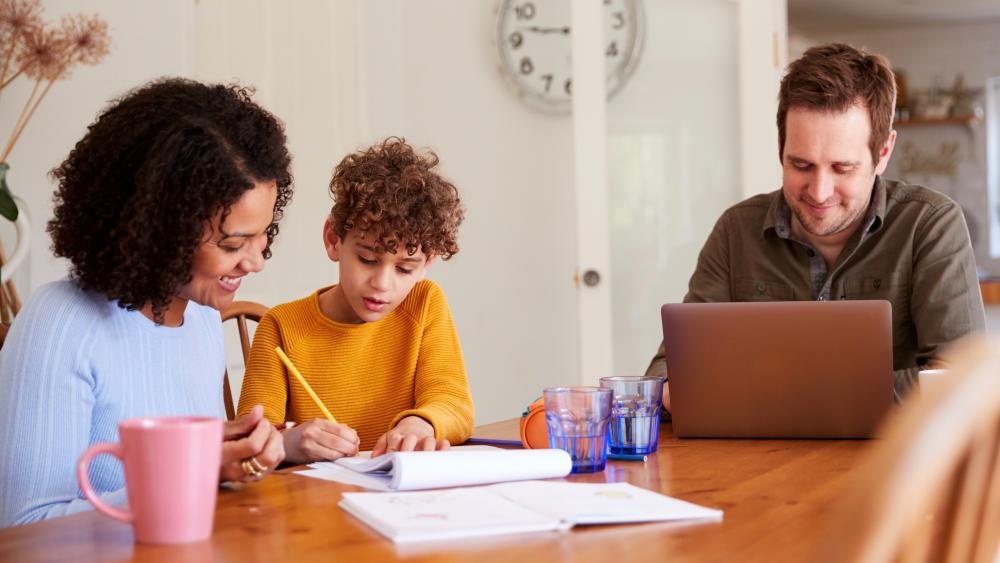 Parents and child homeschooling