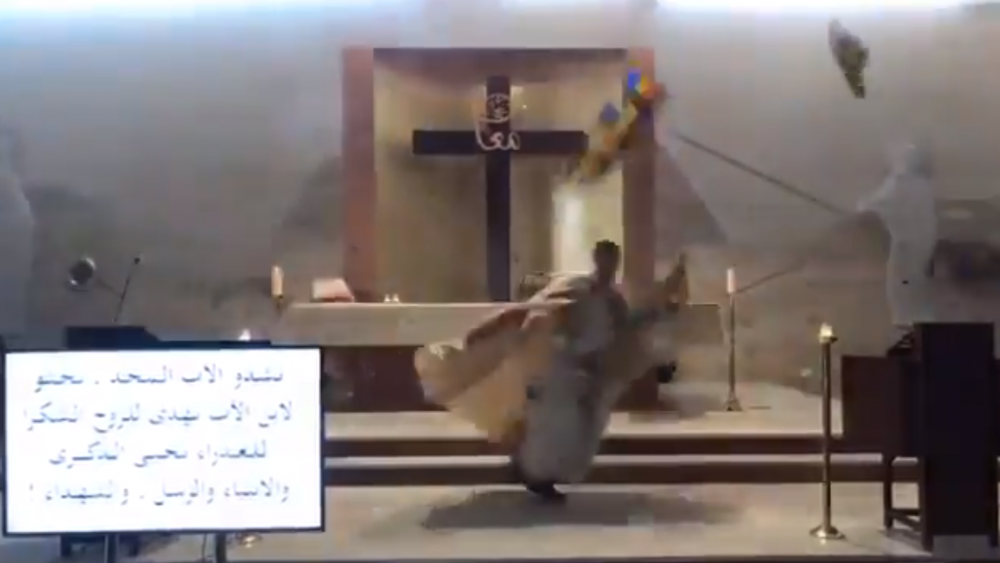 Screenshot of footage of priest in Beirut running for cover amid deadly explosion