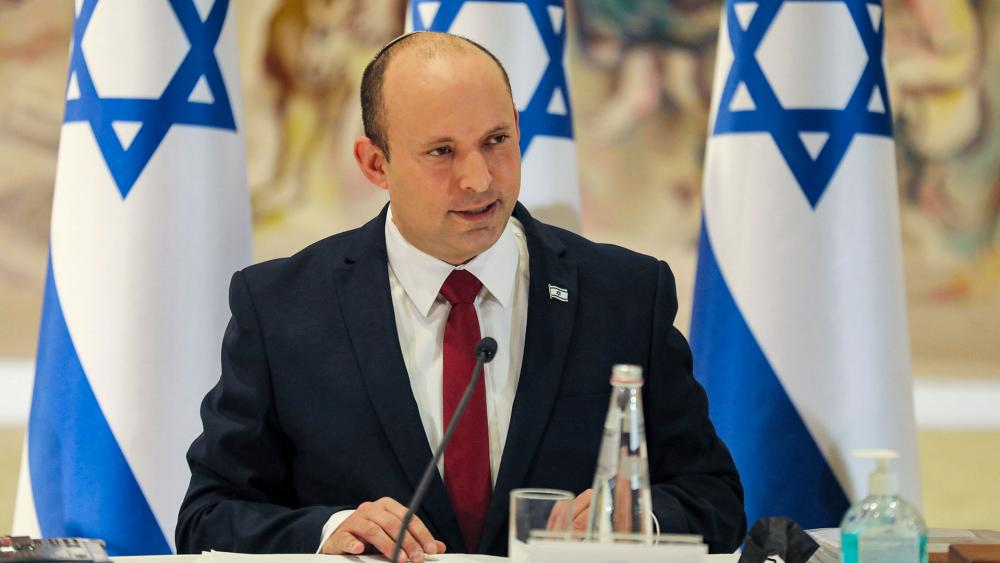 Israeli Prime Minister Naftali Bennett chairs the weekly cabinet meeting in Jerusalem Monday, July 19, 2021. (Gil Cohen-Magen/Pool Photo via AP)