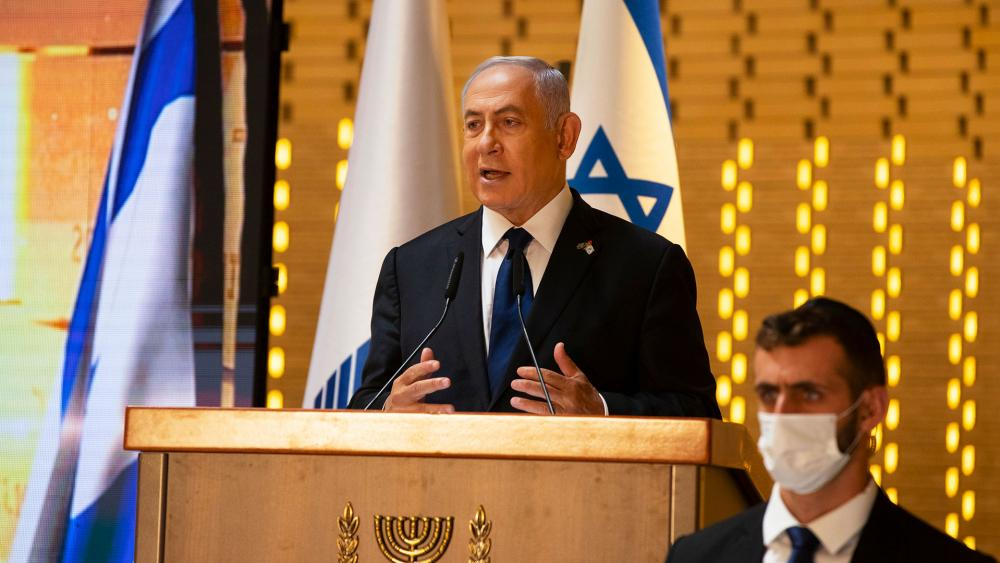 In this Wednesday, April 14, 2021 file photo, Israeli Prime Minister Benjamin Netanyahu speaks at a Memorial Day ceremony at the military cemetery at Mount Herzl, Jerusalem. (AP Photo/Maya Alleruzzo, Pool, File)