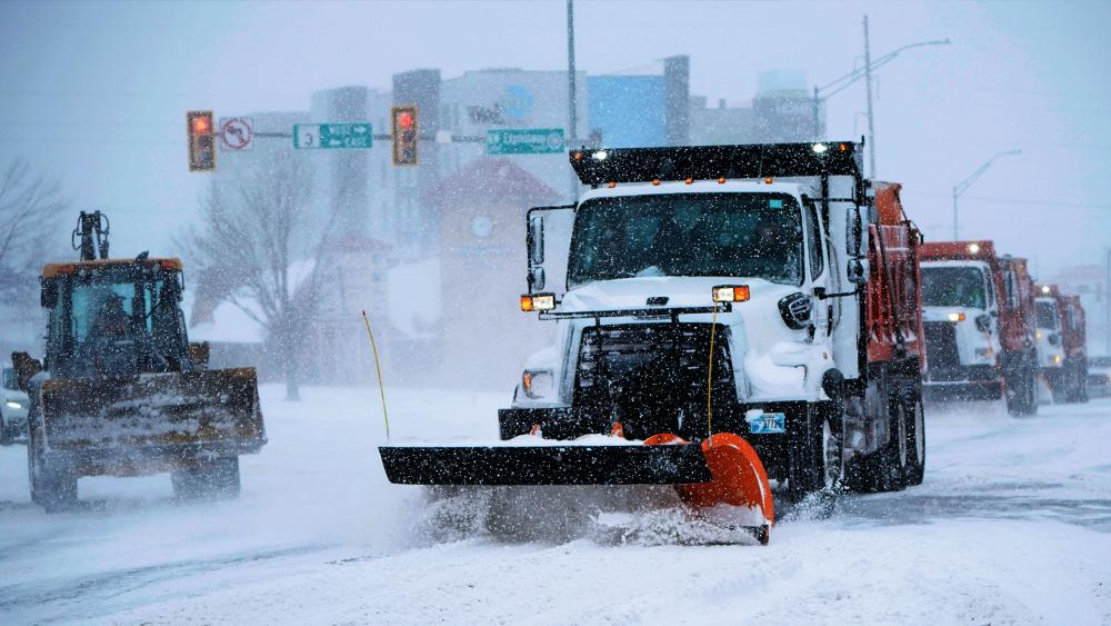 Snow and ice have blanketed large swaths of the U.S., prompting canceled flights, making driving perilous and reaching into areas as far south as Texas' Gulf Coast. (AP Photo/Sue Ogrocki)