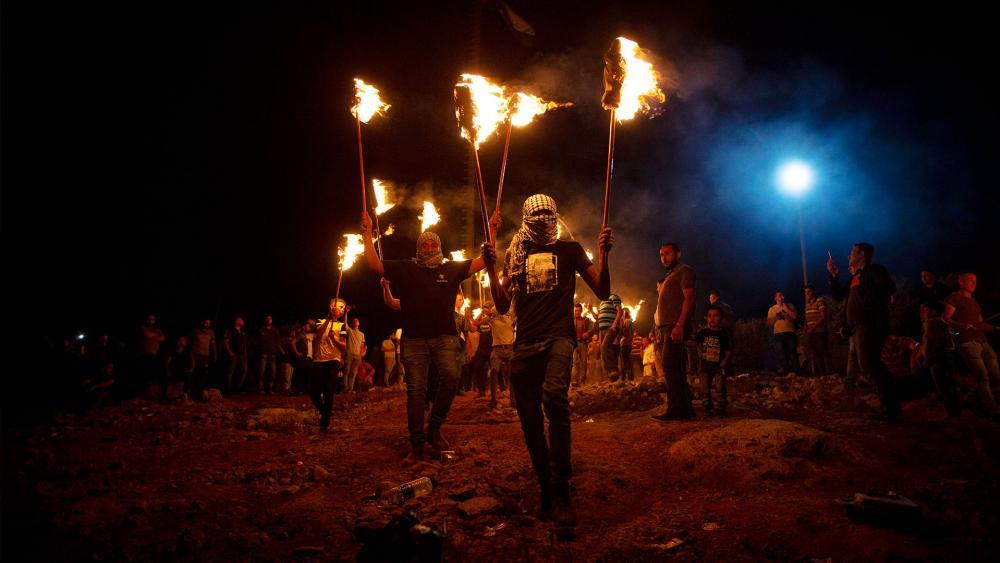 Palestinian demonstrators. Photo Credit: Majdi Mohammed, AP