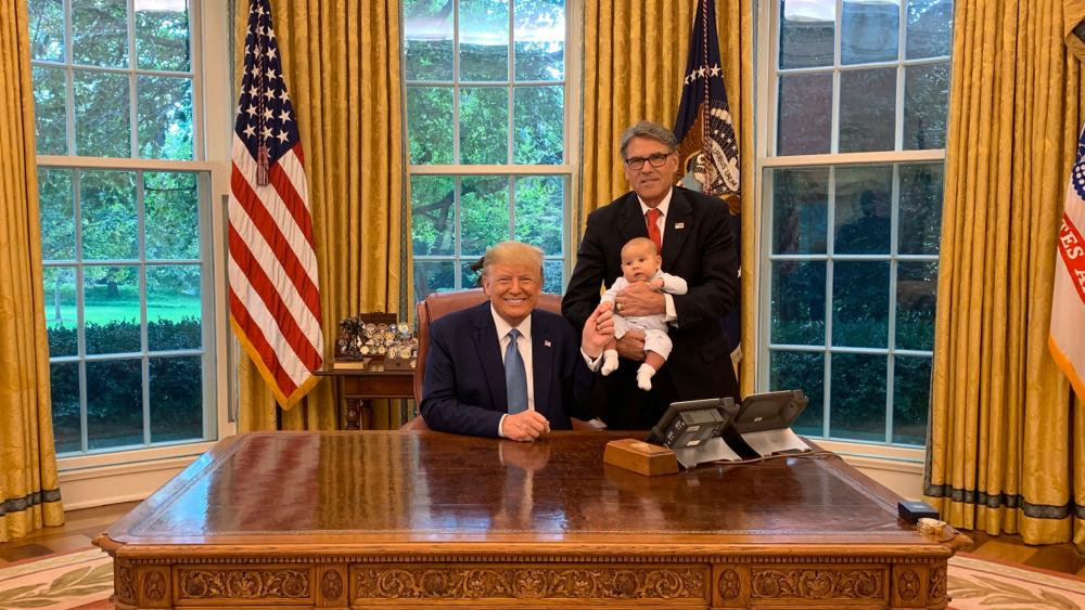 Energy Secretary Rick Perry in the Oval Office with his grandson and President Trump