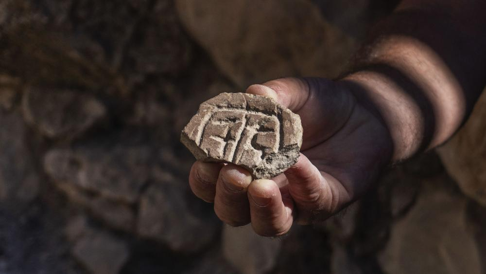 A seal made out of a piece of clay from the Persian Period. Credit: Shai Halevy, Israel Antiquities Authority.
