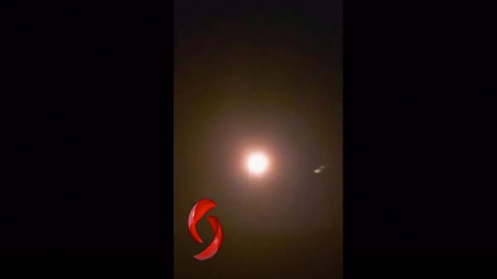 Trace of light from purported missile, bright flash and burst. AP video screenshot via AL-IKHBARIYA SYRIA