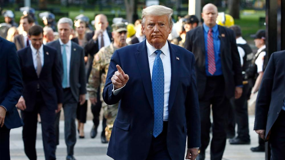 President Donald Trump returns to the White House after visiting outside St. John's Church, Monday, June 1, 2020, in Washington. Part of the church was set on fire during protests on Sunday night. (AP Photo/Patrick Semansky)